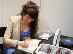 Signing a copy of the book